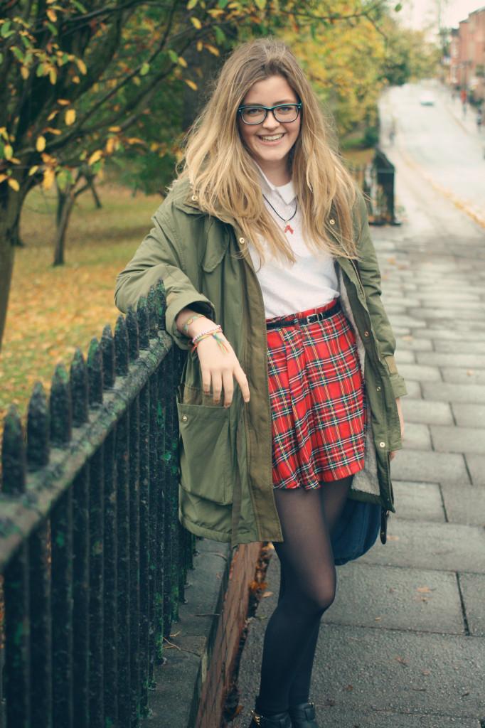 laughing-wearing-tartan-skirt-khaki-parka