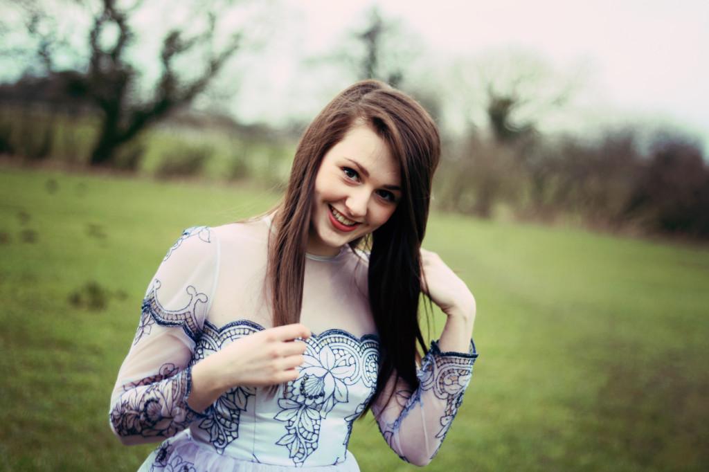 smiling-in-field-wearing-lace-dress