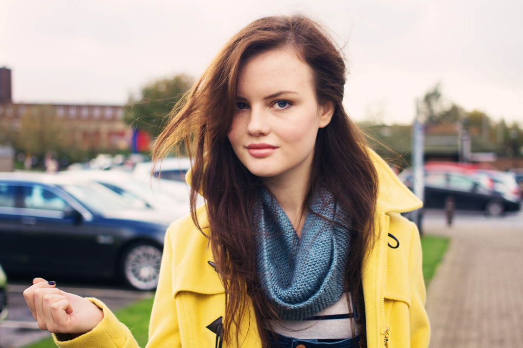 smiling-blue-cowl-yellow-coat