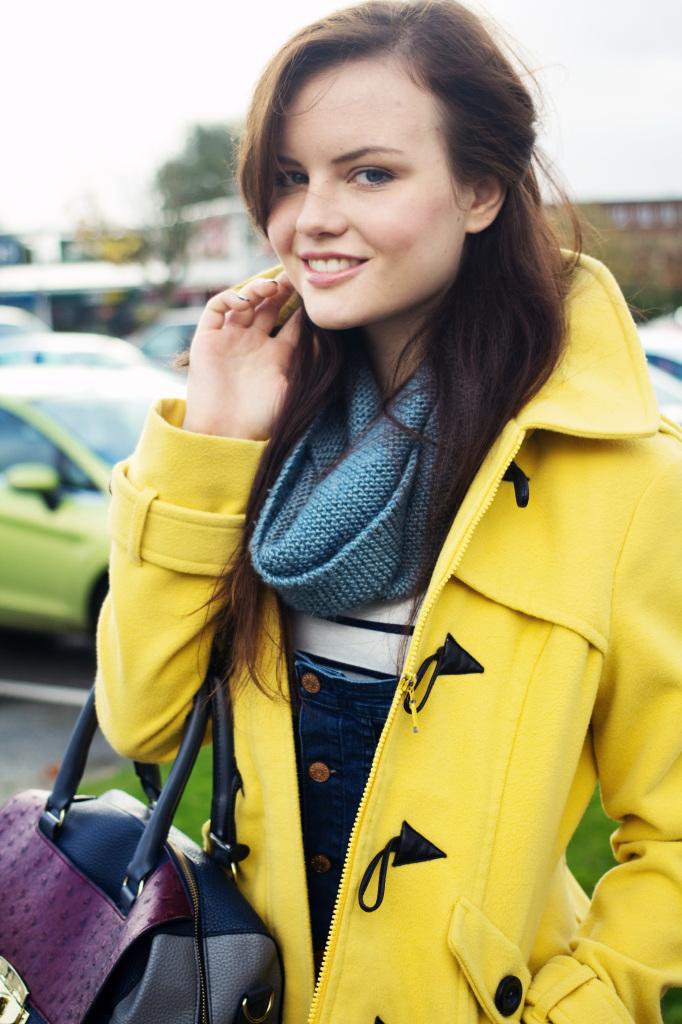 smiling-wearing-yellow-duffle-coat