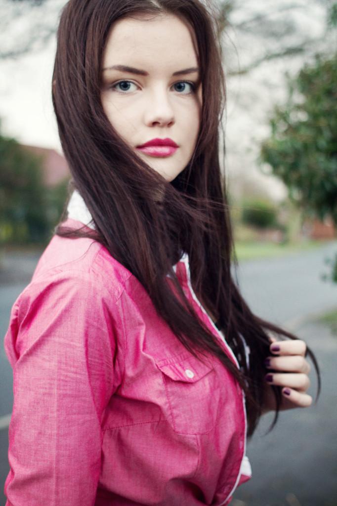 brunette-wearing-pink-shirt