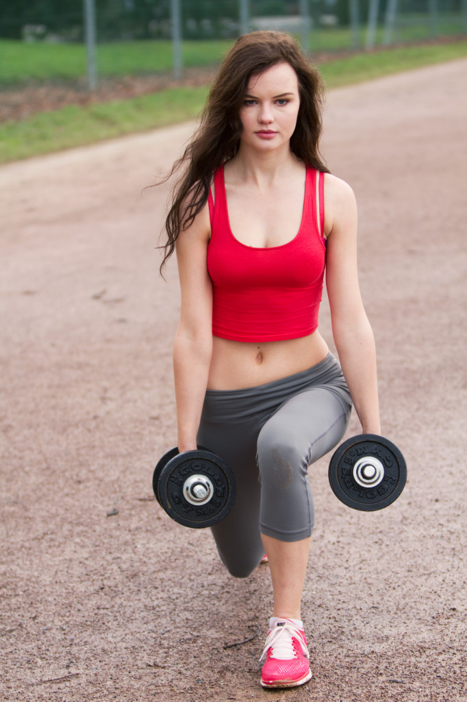 brunette-working-out-with-dumbellls