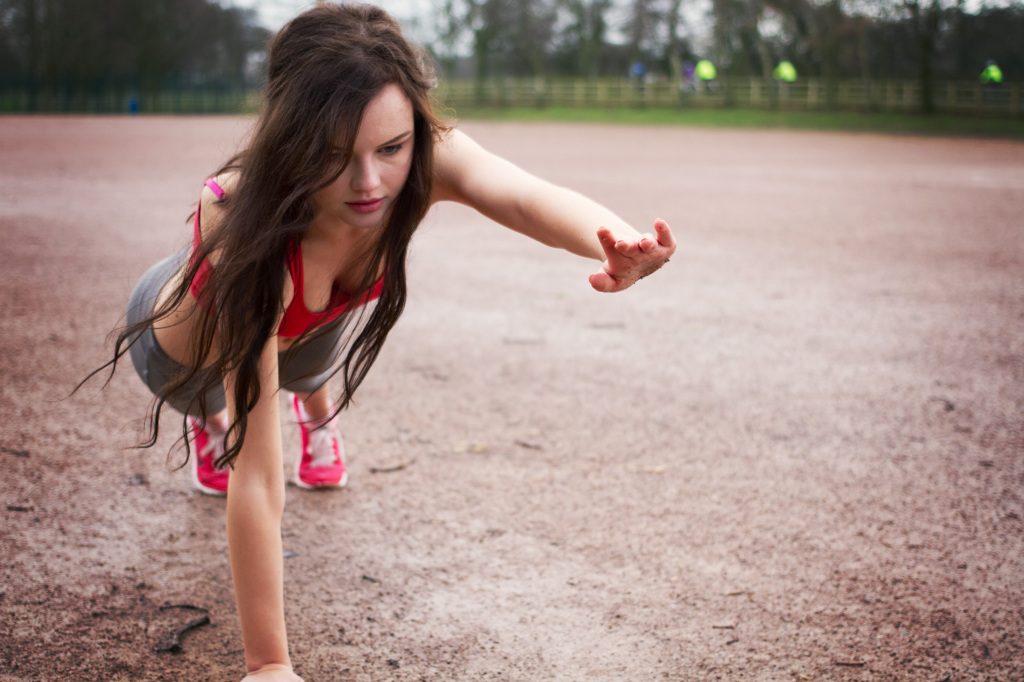 female-doing-arm-raised-plank