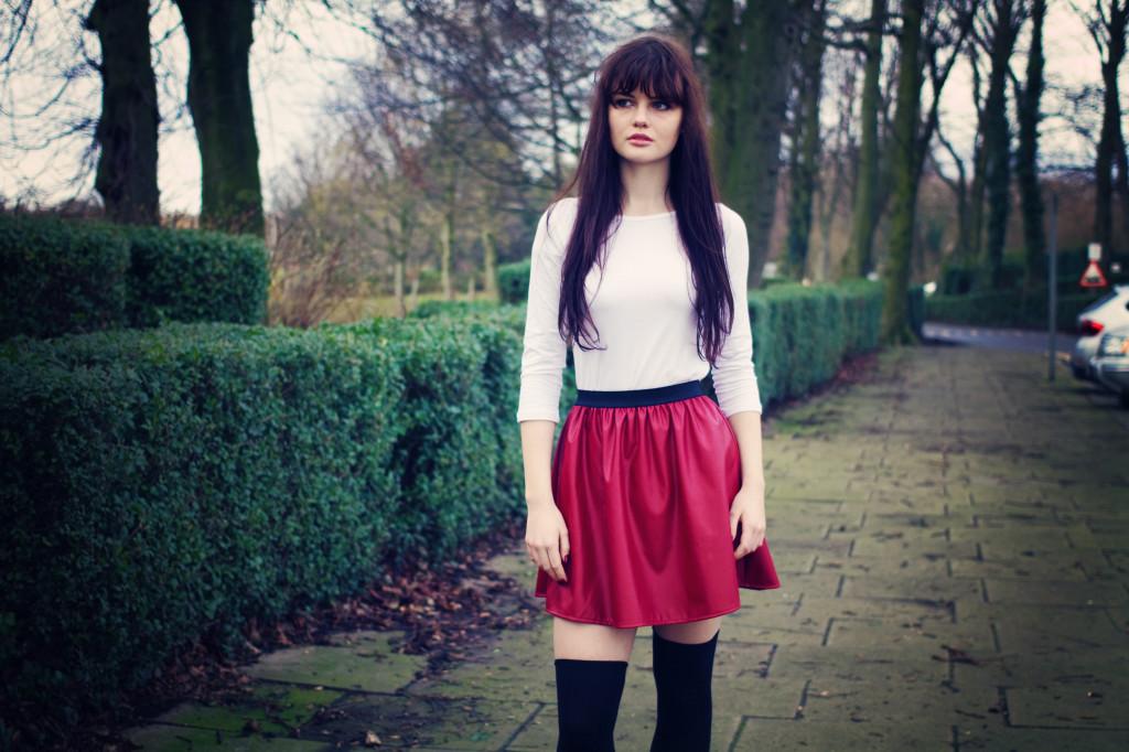 brunette-wearing-red-leather-skater-skirt