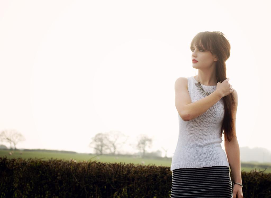 backlit-brunette-in-country-lane