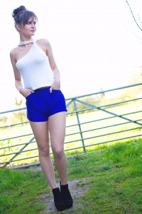 Blue shorts worn with knit white top