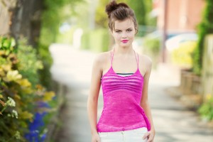 Blogger wearing strappy pink camisole top