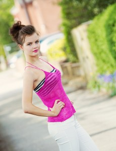 Pink knitted camisole over striped bandeau top
