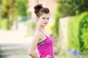 Pink lace camisole worn over stripey bandeau top by teen fashion blogger