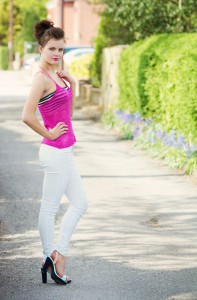 Floaty pink lace knitted camisole worn with white jeans