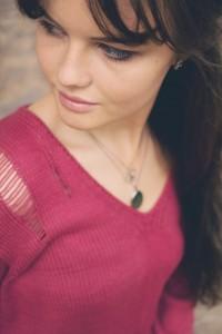oval silver locket on brunette blogger