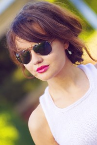 UK fashion blogger wearing primark sunglasses and white racer back top