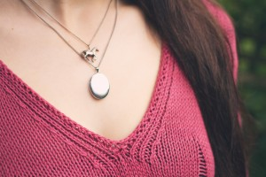 Blogger wearing silver locket and horse pendant