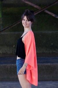 Neon coral kimono worn with denim shorts
