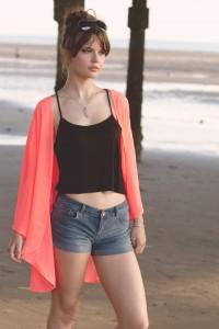 UK teen fashion blogger with messy bun wearing coral kimono