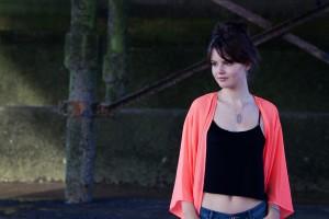 UK teen fashion blogger photographed under pier wearing coral kimono