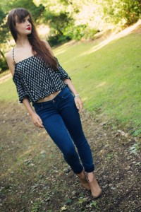 Cropped denim jeans and strappy black top