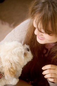 Teen blogger with cute fluffy dog