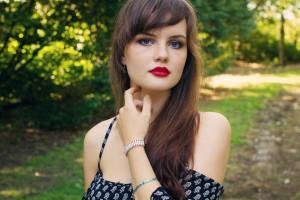 Brunette teen blogger wearing bright red lipstick