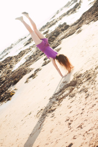UK teen blogger doing handstand at Westport Beach Argyll Scotland