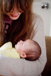 Teen blogger cuddling baby