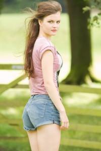 Teen blogger wearing Marley tee and denim shorts