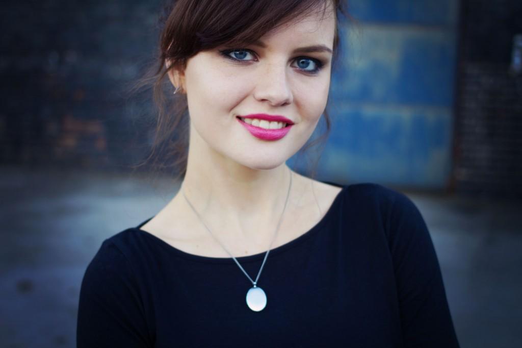 smiling-brunette-wearing-black-primark-top