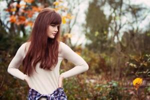 Woodland portrait of teen wearing beige sweater