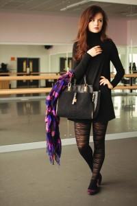 Stripey tights worn with black swing dress