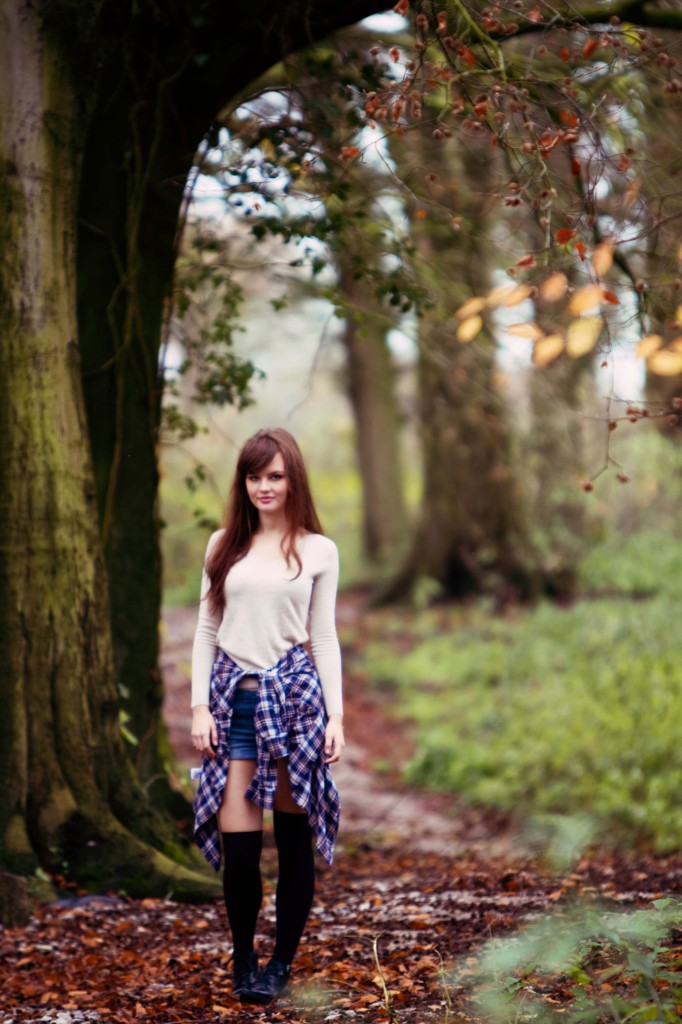 brunette-standing-under-tree