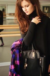 Teen blogger with black New Look handbag