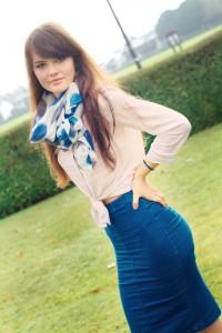 Teen wearing stretch denim midi skirt