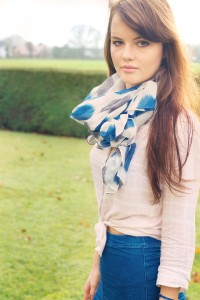 Teen blogger wearing denim midi skirt and blue patterned scarf