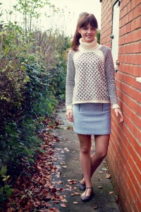 Black and cream honeycomb sweater and blue wool mini skirt
