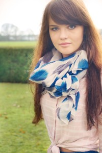Blogger wearing blue and grey patterned scarf