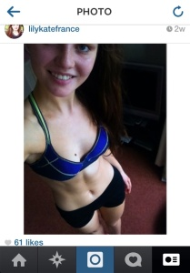 Female blogger showing abs