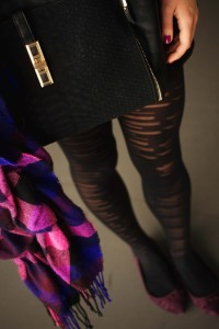 Plum pointed toe shoes worn with stripey tights
