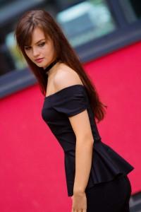 Brunette blogger wearing Bardot style top from Matalan