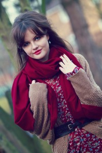 Rich red scarf worn with slouch cardigan and print blouse