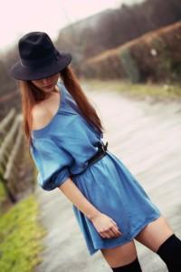 Brunette wearing blue Miss Selfridge off the shoulder dress