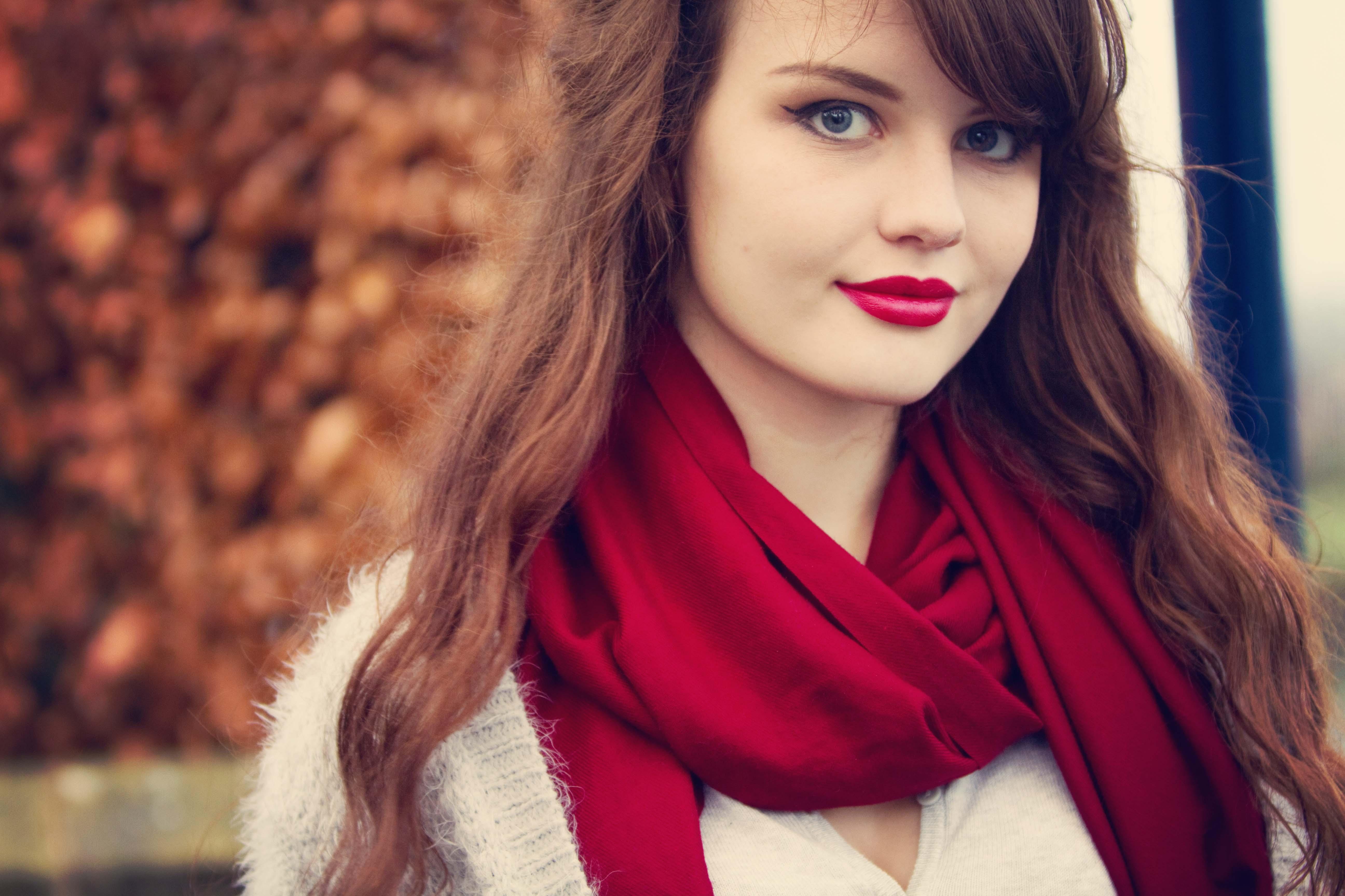 Teenage girl photgraphed against autumnul background