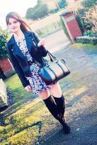 Teen blogger wearing grey floral New Look dress and black biker jacket