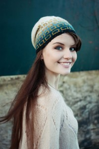 Smiling blogger wearing ombre beanie hat