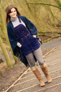 Navy pinafore worn with tan suede boots