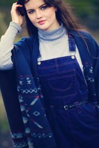 Teen wearing navy pinafore dress