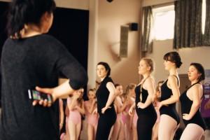 Teen girls rehearsing modern dance routine