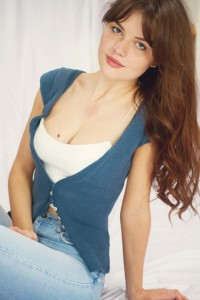 Navy fitted cardigan worn with white bralet