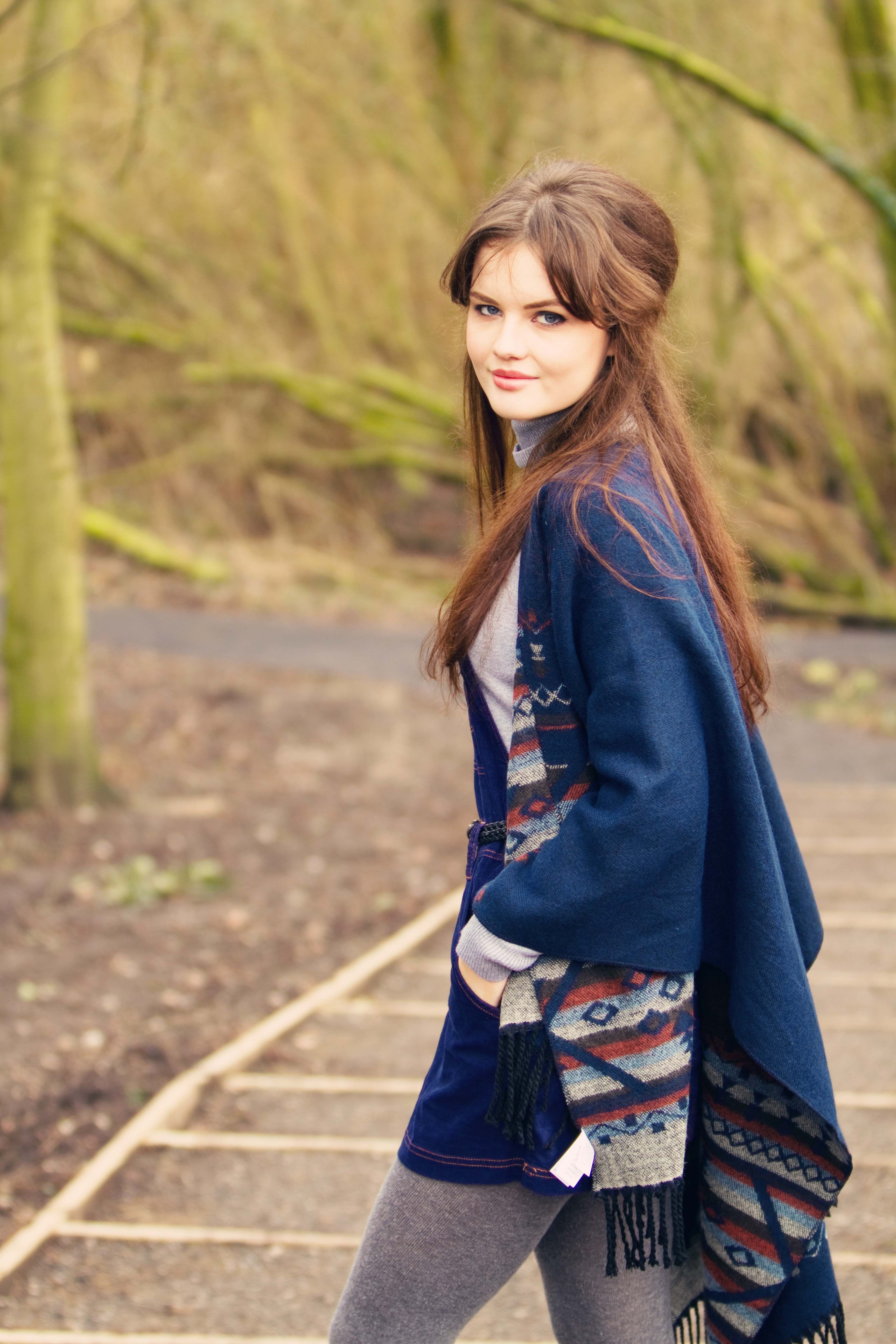 UK teen blogger wearing navy cord pinafore dress and aztec cape
