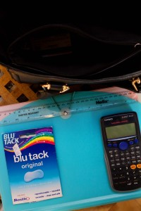 Blu tack pictured with calculator