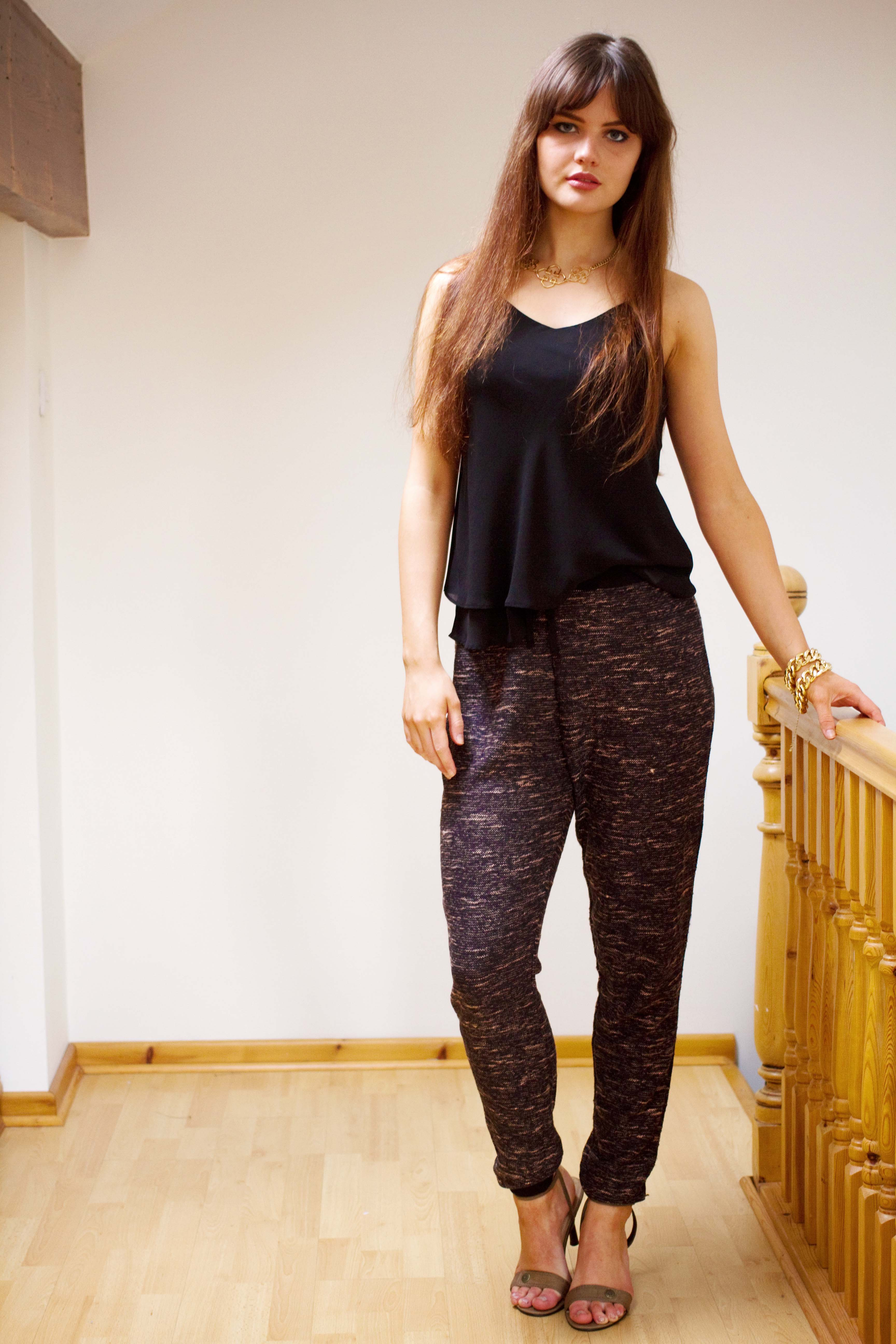 Brunette teen wearing black camisole and textured joggers